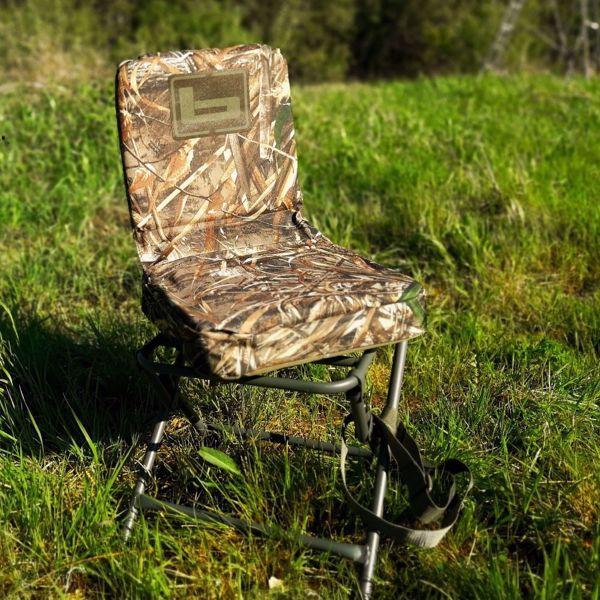 Billede af Banded foldbar stol med drejbart sæde